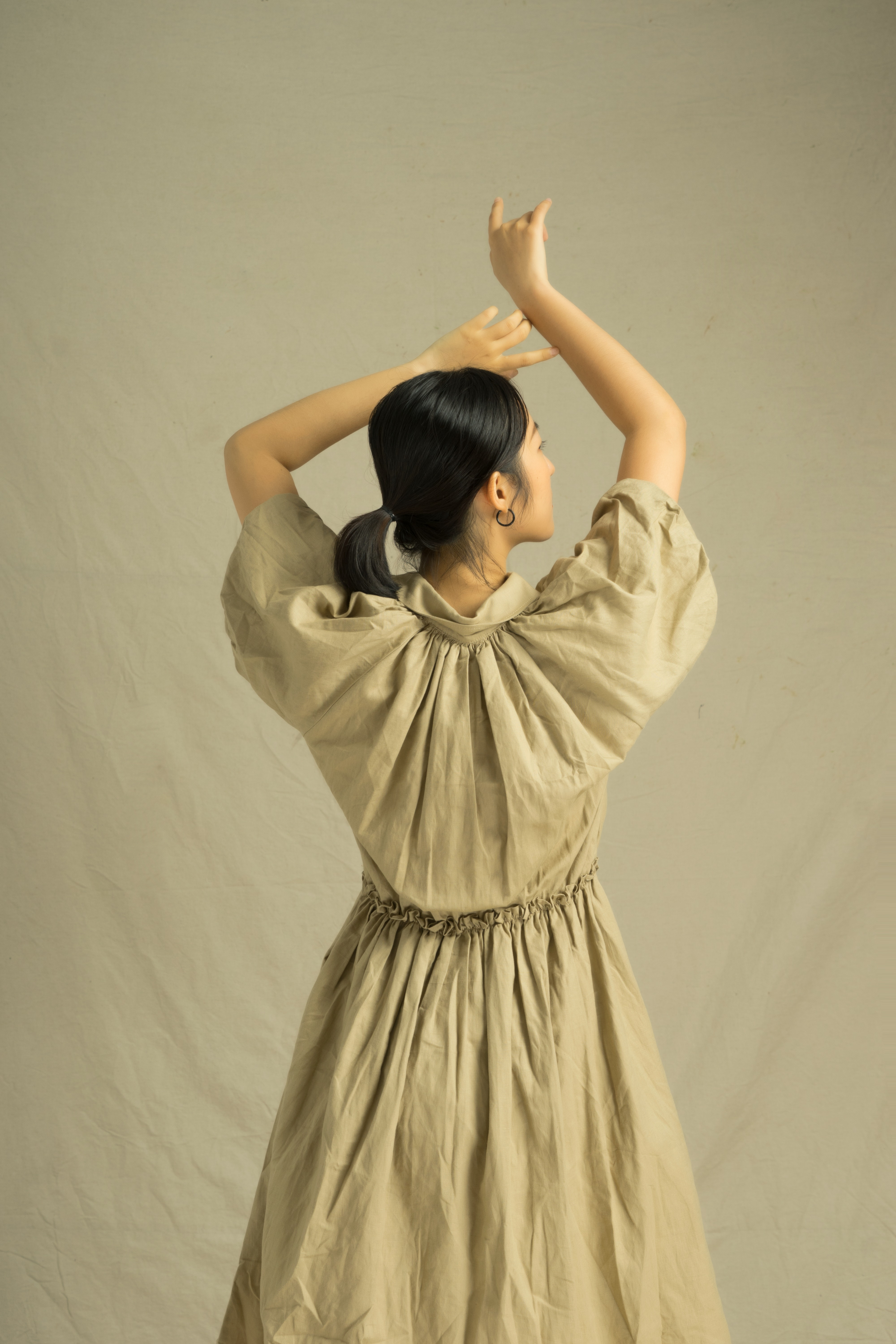 back-view-of-a-woman-in-brown-dress-3866555